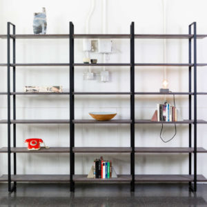 Metal uprights in black colour. Plywood shelves with grey tint.